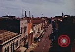 Image of Street scenes with buildings, traffic, and Aloha Tower in distance Honolulu Hawaii USA, 1942, second 22 stock footage video 65675063478