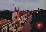 Image of Street scenes with buildings, traffic, and Aloha Tower in distance Honolulu Hawaii USA, 1942, second 23 stock footage video 65675063478