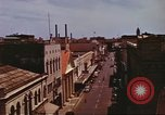Image of Street scenes with buildings, traffic, and Aloha Tower in distance Honolulu Hawaii USA, 1942, second 24 stock footage video 65675063478
