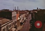 Image of Street scenes with buildings, traffic, and Aloha Tower in distance Honolulu Hawaii USA, 1942, second 25 stock footage video 65675063478