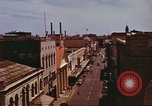 Image of Street scenes with buildings, traffic, and Aloha Tower in distance Honolulu Hawaii USA, 1942, second 27 stock footage video 65675063478