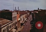 Image of Street scenes with buildings, traffic, and Aloha Tower in distance Honolulu Hawaii USA, 1942, second 29 stock footage video 65675063478