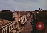 Image of Street scenes with buildings, traffic, and Aloha Tower in distance Honolulu Hawaii USA, 1942, second 31 stock footage video 65675063478