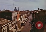 Image of Street scenes with buildings, traffic, and Aloha Tower in distance Honolulu Hawaii USA, 1942, second 32 stock footage video 65675063478
