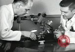 Image of Microscopic precision machining in a laboratory United States USA, 1954, second 26 stock footage video 65675063494