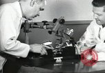 Image of Microscopic precision machining in a laboratory United States USA, 1954, second 28 stock footage video 65675063494