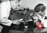 Image of Microscopic precision machining in a laboratory United States USA, 1954, second 32 stock footage video 65675063494