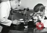 Image of Microscopic precision machining in a laboratory United States USA, 1954, second 33 stock footage video 65675063494