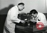 Image of Microscopic precision machining in a laboratory United States USA, 1954, second 59 stock footage video 65675063494
