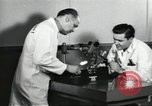Image of Microscopic precision machining in a laboratory United States USA, 1954, second 60 stock footage video 65675063494