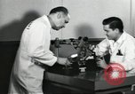 Image of Microscopic precision machining in a laboratory United States USA, 1954, second 62 stock footage video 65675063494