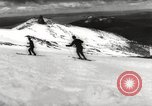Image of skiing in spring Argentina, 1960, second 28 stock footage video 65675063694