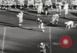 Image of Football match Baltimore Maryland USA, 1960, second 14 stock footage video 65675063696