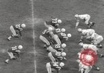 Image of Football match Baltimore Maryland USA, 1960, second 40 stock footage video 65675063696