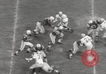 Image of Football match Baltimore Maryland USA, 1960, second 42 stock footage video 65675063696