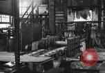 Image of Forging saw blades at Disston Saw works factory Philadelphia Pennsvlvania USA, 1920, second 2 stock footage video 65675063729