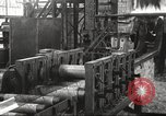 Image of Forging saw blades at Disston Saw works factory Philadelphia Pennsvlvania USA, 1920, second 40 stock footage video 65675063729