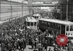 Image of trolleys outside factory United States USA, 1918, second 2 stock footage video 65675063746
