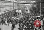 Image of trolleys outside factory United States USA, 1918, second 13 stock footage video 65675063746