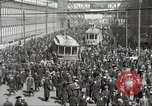 Image of trolleys outside factory United States USA, 1918, second 14 stock footage video 65675063746