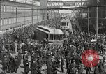 Image of trolleys outside factory United States USA, 1918, second 16 stock footage video 65675063746