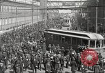 Image of trolleys outside factory United States USA, 1918, second 20 stock footage video 65675063746
