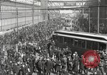 Image of trolleys outside factory United States USA, 1918, second 21 stock footage video 65675063746