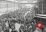 Image of trolleys outside factory United States USA, 1918, second 23 stock footage video 65675063746