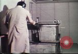 Image of Federal Bureau of Investigation fingerprint analysis Washington DC USA, 1977, second 21 stock footage video 65675063776