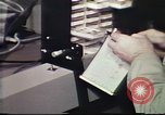 Image of Federal Bureau of Investigation fingerprint analysis Washington DC USA, 1977, second 57 stock footage video 65675063776