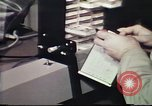 Image of Federal Bureau of Investigation fingerprint analysis Washington DC USA, 1977, second 58 stock footage video 65675063776