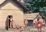 Image of US 5th Marines occupy Bitokara Mission compound Talasea New Britain Papua New Guinea, 1944, second 30 stock footage video 65675063813