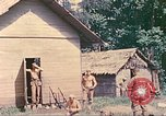 Image of US 5th Marines occupy Bitokara Mission compound Talasea New Britain Papua New Guinea, 1944, second 33 stock footage video 65675063813