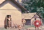 Image of US 5th Marines occupy Bitokara Mission compound Talasea New Britain Papua New Guinea, 1944, second 34 stock footage video 65675063813