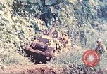 Image of US 5th Marines use winch to pull armored vehicle uphill Talasea New Britain Papua New Guinea, 1944, second 5 stock footage video 65675063814