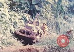 Image of US 5th Marines use winch to pull armored vehicle uphill Talasea New Britain Papua New Guinea, 1944, second 6 stock footage video 65675063814
