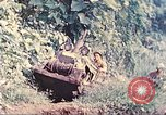 Image of US 5th Marines use winch to pull armored vehicle uphill Talasea New Britain Papua New Guinea, 1944, second 7 stock footage video 65675063814