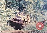 Image of US 5th Marines use winch to pull armored vehicle uphill Talasea New Britain Papua New Guinea, 1944, second 8 stock footage video 65675063814