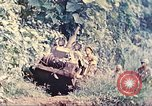Image of US 5th Marines use winch to pull armored vehicle uphill Talasea New Britain Papua New Guinea, 1944, second 9 stock footage video 65675063814
