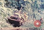 Image of US 5th Marines use winch to pull armored vehicle uphill Talasea New Britain Papua New Guinea, 1944, second 10 stock footage video 65675063814