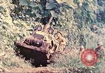 Image of US 5th Marines use winch to pull armored vehicle uphill Talasea New Britain Papua New Guinea, 1944, second 11 stock footage video 65675063814