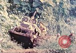 Image of US 5th Marines use winch to pull armored vehicle uphill Talasea New Britain Papua New Guinea, 1944, second 12 stock footage video 65675063814