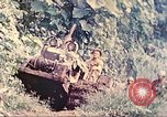 Image of US 5th Marines use winch to pull armored vehicle uphill Talasea New Britain Papua New Guinea, 1944, second 14 stock footage video 65675063814