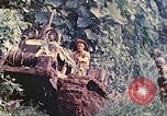 Image of US 5th Marines use winch to pull armored vehicle uphill Talasea New Britain Papua New Guinea, 1944, second 15 stock footage video 65675063814