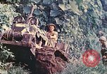 Image of US 5th Marines use winch to pull armored vehicle uphill Talasea New Britain Papua New Guinea, 1944, second 16 stock footage video 65675063814