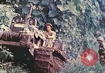 Image of US 5th Marines use winch to pull armored vehicle uphill Talasea New Britain Papua New Guinea, 1944, second 17 stock footage video 65675063814