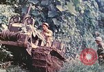 Image of US 5th Marines use winch to pull armored vehicle uphill Talasea New Britain Papua New Guinea, 1944, second 18 stock footage video 65675063814