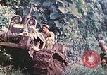 Image of US 5th Marines use winch to pull armored vehicle uphill Talasea New Britain Papua New Guinea, 1944, second 19 stock footage video 65675063814