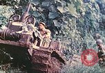 Image of US 5th Marines use winch to pull armored vehicle uphill Talasea New Britain Papua New Guinea, 1944, second 20 stock footage video 65675063814