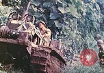 Image of US 5th Marines use winch to pull armored vehicle uphill Talasea New Britain Papua New Guinea, 1944, second 21 stock footage video 65675063814